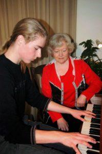 Pianoles met leerling in Amersfoort
